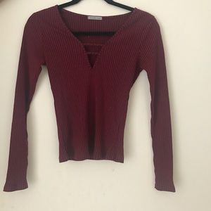 Maroon stretchy top with neck detail